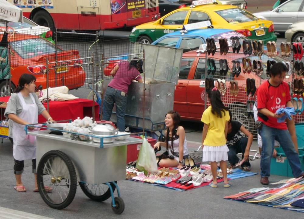 Happy, Smiling Faces - A lively Bangkok Street Scene