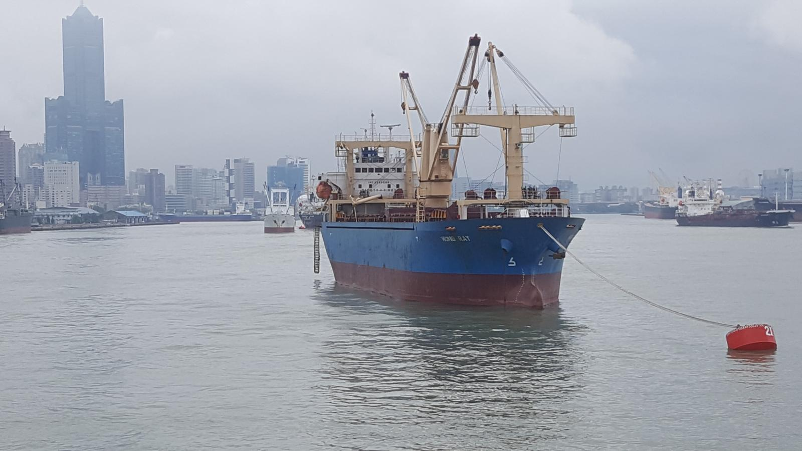 Blue-hulled cargo ship tied up to buoys in Kaohsiung