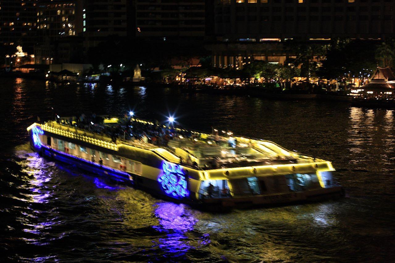 River boat all lit up at night on the Jao Praya River in Bangkok.jpg