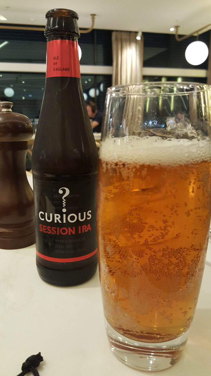 A glass of Curious? session IPA at BKK