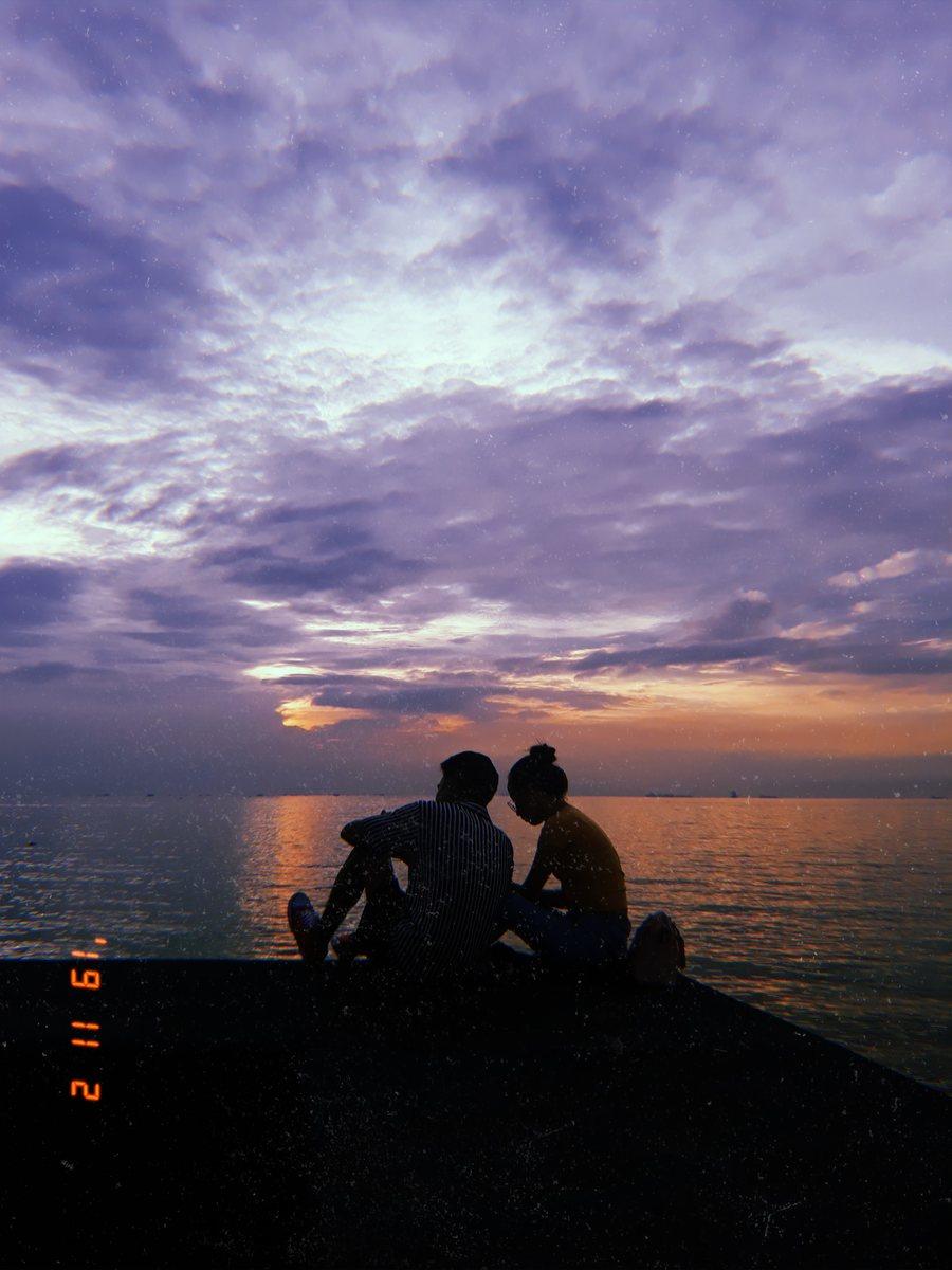 Couple watching Manila Bay Sunset at Mall of Asia