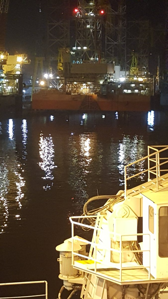Hamriyah port at night with lights reflecting off the smooth waters of the harbour