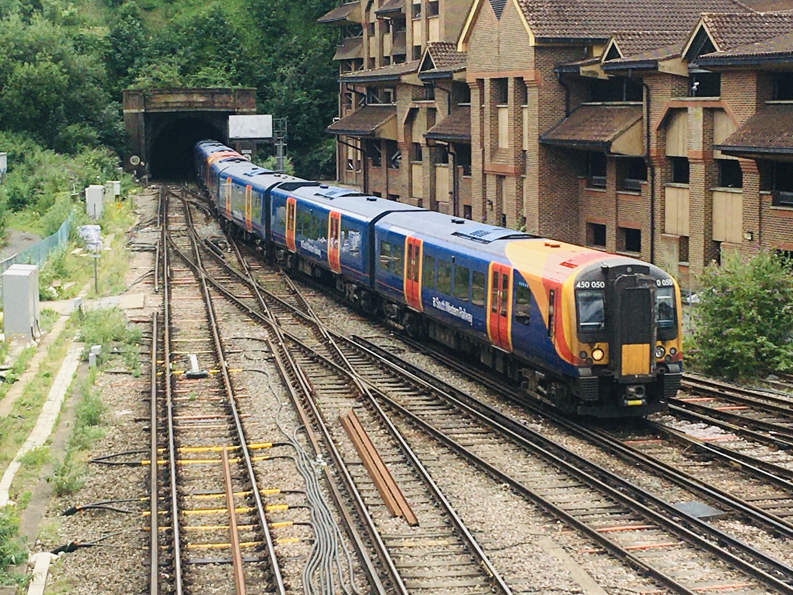 South Western Railway Class 450 Desiro emerges from Chalk Tunnel at Guildforf